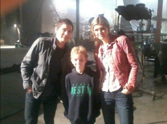 Logan Lerman and Alexandra Daddario with a fan Percy Jackson movie Sea of Monsters